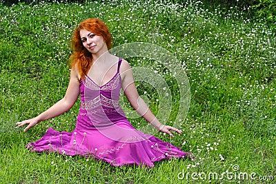 Ginger girl in purple dress