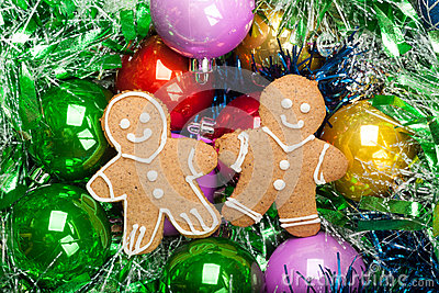 Gingerbread Christmas Men with bunch of Colorful baubles and tin Stock Photo