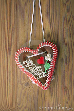 Gingerbread heart with wooden background