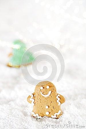 Gingerbread man and christmas tree on a festive Christmas snow