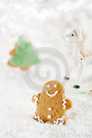 Gingerbread man and tree on a festive Christmas snow background
