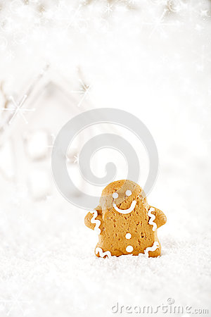 Gingerbread man and wooden house on a festive Christmas snow