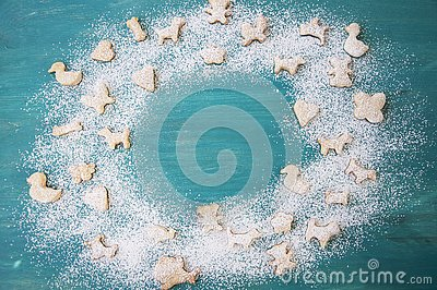 Gingerbread with powdered sugar on wooden background. Christmas cookies. Copy space. Stock Photo