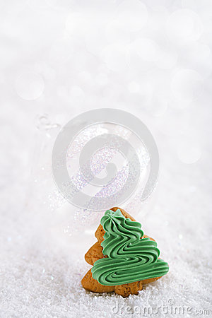 Gingerbread tree on a festive Christmas snow background, nice po
