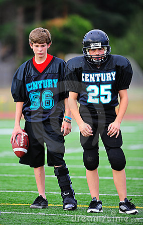 Giocatore danneggiato football americano della gioventù Fotografia Editoriale