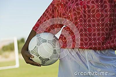 Girl (13-17) holding soccer ball