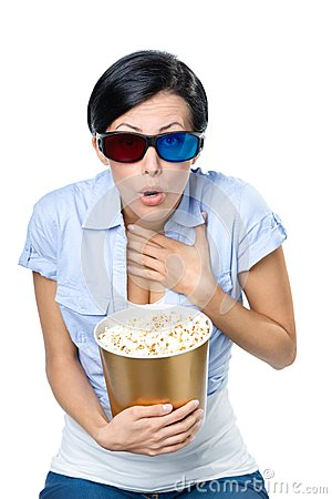 Girl in 3D glasses watching cinema with bowl of popcorn