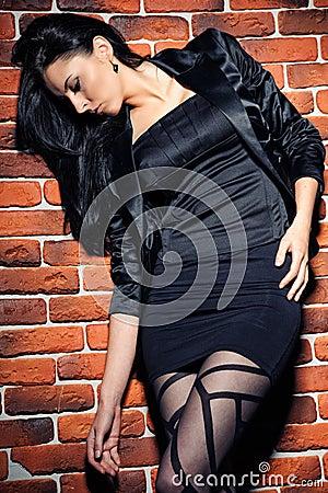 Girl against  brick wall