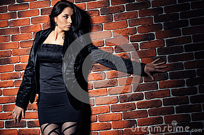 Girl against  brick wall