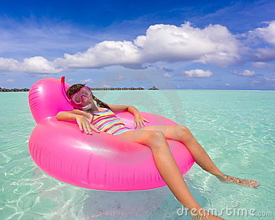 Girl on air mattress in sea