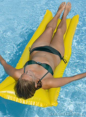 Girl on an airbed in a swimming pool