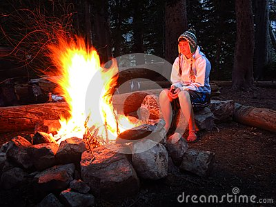 Girl Alone by Campfire While Camping