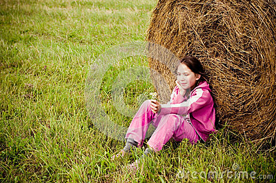 Girl alone in meadow
