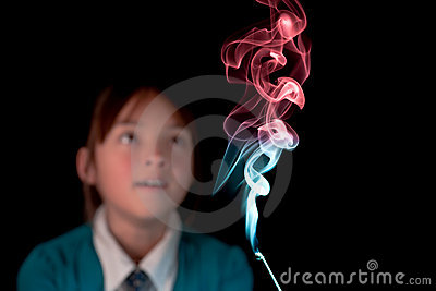 Girl amazed by the smoke.