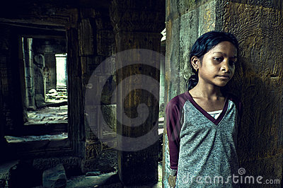 Girl from Angkor Wat. Ta Som Temple Editorial Stock Photo