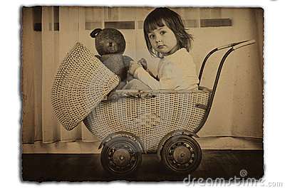 Girl in antique baby carriage