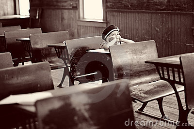 Girl at antique school desk