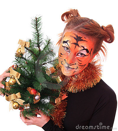 Girl in appearance a tiger with a new-year tree.