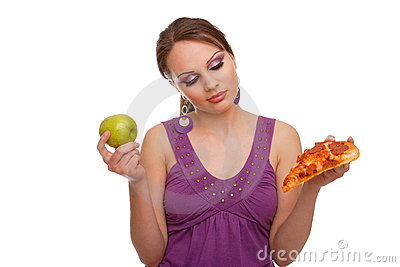 Girl with apple and pizza making a decision