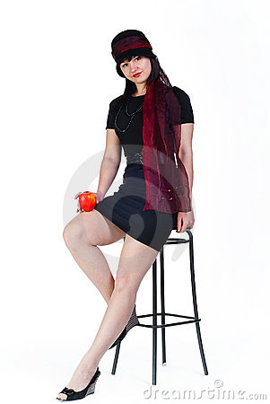 Girl with apple on stool
