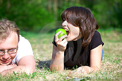 Girl with an apple and a young man