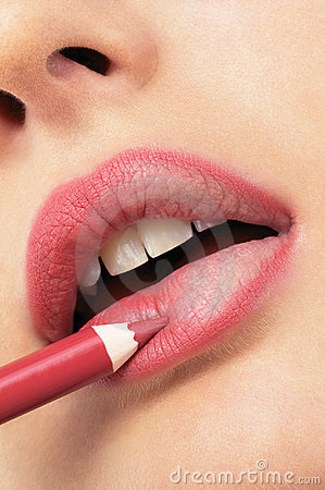 Girl applying lip liner