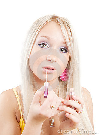 Girl applying lipstick over white