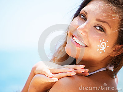 Girl applying Sun Tan Cream