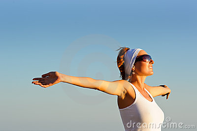 Girl with arms raised towards the sky