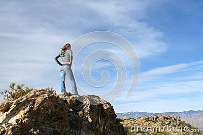 Girl atop of a rock
