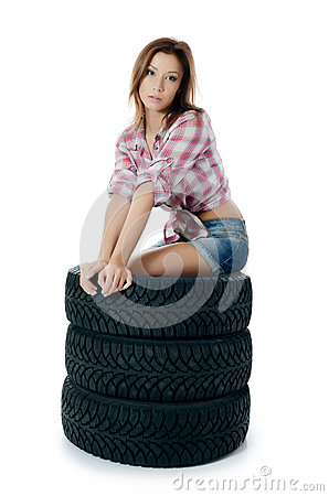 Girl with automobile tyres
