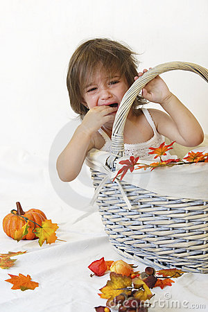 Girl and autumn basket