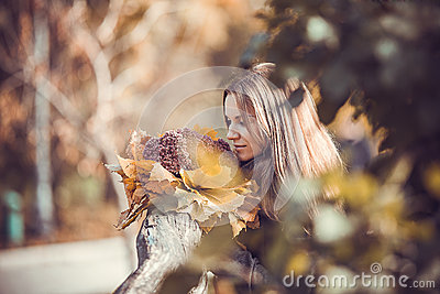 Girl with autumn bouquet in park