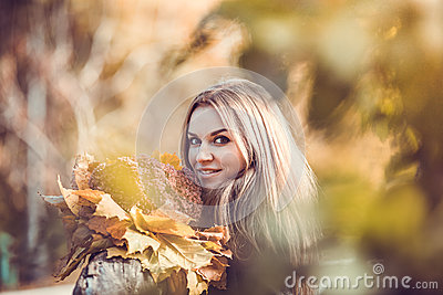 Girl with autumn bouquet