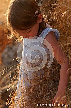 Girl in autumn countryside