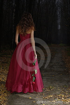 Girl in autumn forest