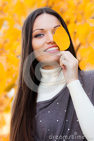 Girl in autumn garden