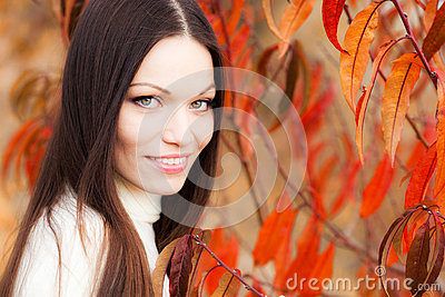 Girl in autumn garden