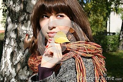 The girl with an autumn leaf.