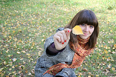 The girl with an autumn leaf.