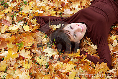 Girl in the autumn leafs