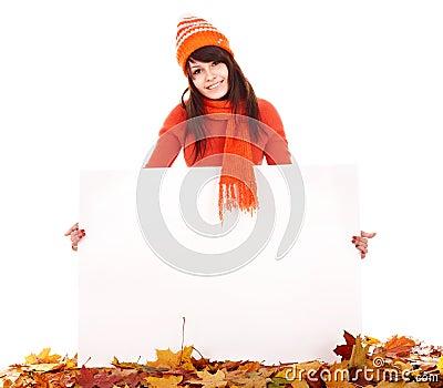 Girl in autumn orange sweater holding banner.