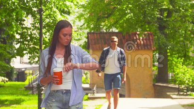 Girl awaiting her boyfriend in a park. Man delaying to date. Love and relations. Girl awaiting her boyfriend in a park. Man delaying to date. Love and relations stock footage