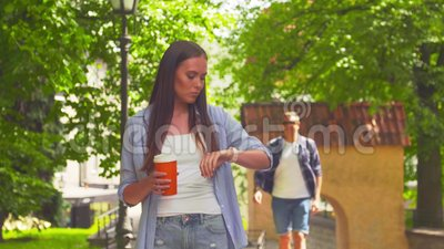 Girl awaiting her boyfriend in a park. Man delaying to date. Love and relations. Girl awaiting her boyfriend in a park. Man delaying to date. Love and relations stock video footage