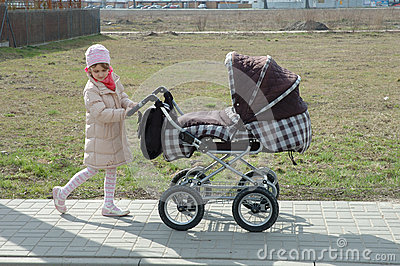 Girl with baby carrier