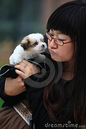 Girl with baby dog