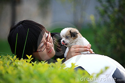 Girl and baby dog