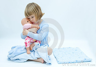 Girl and baby doll