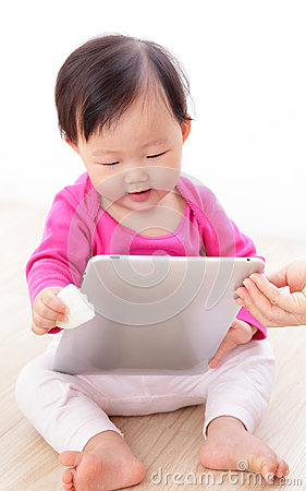 Girl baby happy play tablet PC