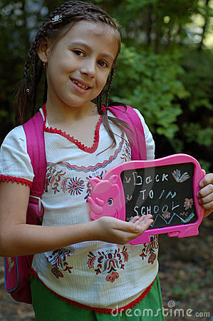 Girl with back to school sign